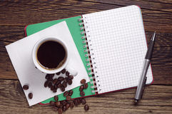 Coffee, opened notebook and pen Royalty Free Stock Photos