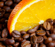 Coffee with orange. Coffee beans and orange segment Stock Images