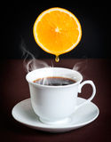 Coffee with orange. Cup of Coffee with orange on dark background Stock Photography