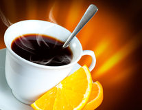Coffee with orange. Cup of Coffee with orange on dark background Stock Image