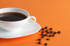 Coffee on the orange background Royalty Free Stock Image