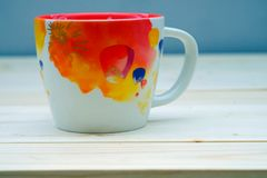 Coffee Orange Cup. On Table Wood Royalty Free Stock Photos
