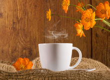 Coffee with orange flowers Royalty Free Stock Images
