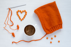 Coffee, orange and handmade hat on white background Stock Photo