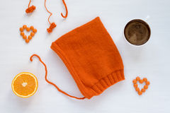 Coffee, orange and handmade hat on white background Royalty Free Stock Photos