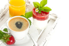 Coffee, orange juice and strawberry yogurt Stock Images