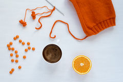 Coffee, orange and woolen hat on white background Royalty Free Stock Photo