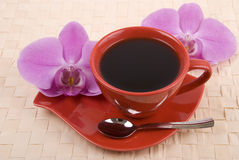 Coffee and orchid Stock Photo