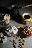Coffee and oriental sweets. A mug of coffee and different oriental sweets: turkish delight, halva, almond and pistachio stock photos