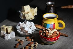 Coffee and oriental sweets. A mug of coffee and different oriental sweets: turkish delight, halva, almond and pistachio stock images