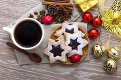 Coffee ornament and star cookies Stock Photos