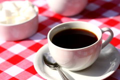 Coffee outside on table. Photograph of a cup of coffee with milk and sugar cubes Royalty Free Stock Photo