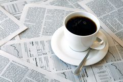 Coffee over newspaper Royalty Free Stock Images
