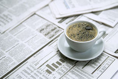 Coffee over newspaper. Office and business Royalty Free Stock Photo