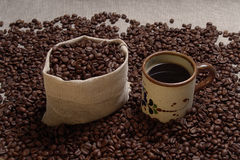 Coffee pack6.jpg. Bag and cup full of coffee beans Stock Images