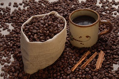 Coffee pack7.jpg. Coffee pack, cup and cinnamon Royalty Free Stock Image