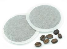 Coffee pads and beans Royalty Free Stock Photos