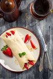 Coffee and pancakes with strawberries served on breakfast royalty free stock images