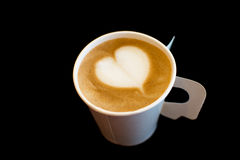 Coffee. A paper cup of coffee with heart shape on Black background Stock Photography
