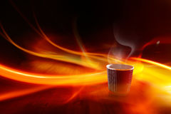 Coffee paper cup and lights Stock Photos