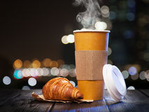 Coffee in a paper cup royalty free stock photos