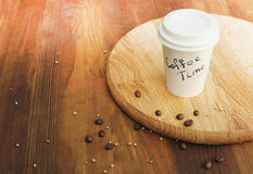 Coffee paper cup on vintage wooden background Royalty Free Stock Images