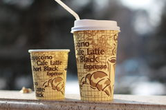 Coffee paper cups. A small and a large coffee paper cups with a straw Stock Photo