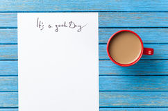 Coffee and paper with Good day inscription Royalty Free Stock Photo