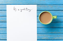 Coffee and paper with Good day inscription Royalty Free Stock Photography