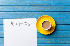 Coffee and paper with Good day inscription Stock Image