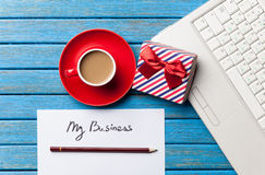 Coffee and paper with My Business inscription near notebook Stock Images