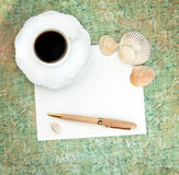 Coffee with Paper, Pen and Shells Stock Photography