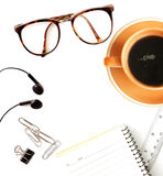 Coffee, paperclip, notebook, eyeglasses and earphone Royalty Free Stock Photos