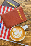 Coffee, passports and USA flag. Stock Photo
