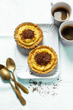 Coffee and pastries. Mini tart with lemon curd and chocolate . h Stock Photos