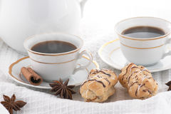 Coffee with pastry. Cups of coffee, with spices and biscuit Royalty Free Stock Photos