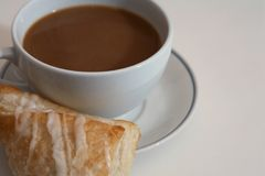 Coffee and pastry on white Royalty Free Stock Photos