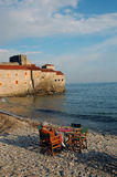 Coffee pause at the beach. Beach Richard's Head in Budva with man seating royalty free stock images