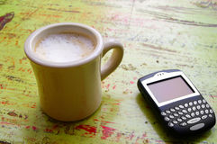 Coffee and pda Stock Photography