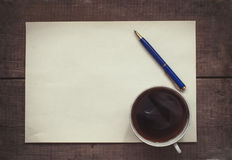 Coffee, pen and blank paper Stock Photos