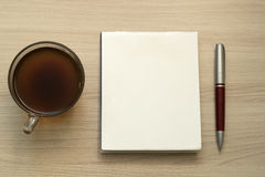 Coffee, pen and blank piece of paper Stock Images