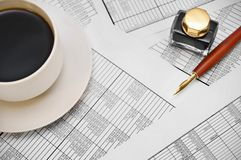 Coffee and pen on the documents . Stock Images