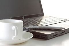 Coffee , pen and laptop Royalty Free Stock Photos