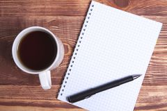 Coffee pen and notebook stock photo