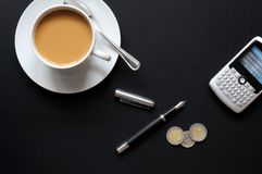 Coffee pen phone and paper Stock Image