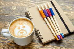 Coffee, pencils and notebook. Stock Photos