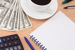 Coffee, pens, pad and dollars Royalty Free Stock Image