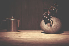 Coffee percolator, black grapes on wooden table, copy space. Stock Images