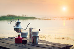 Coffee percolator on a campfire at morning. Close-up at sunset Stock Photography