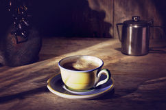 Coffee percolator, cup of coffee, black grapes on wooden table, Royalty Free Stock Images
